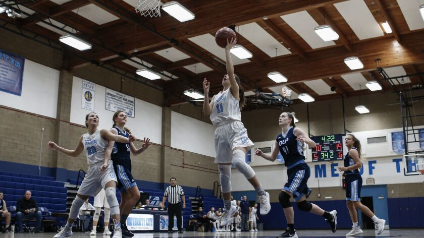 University City point guard Morgan Wills (11) goes for a layup in the second period against OLP.