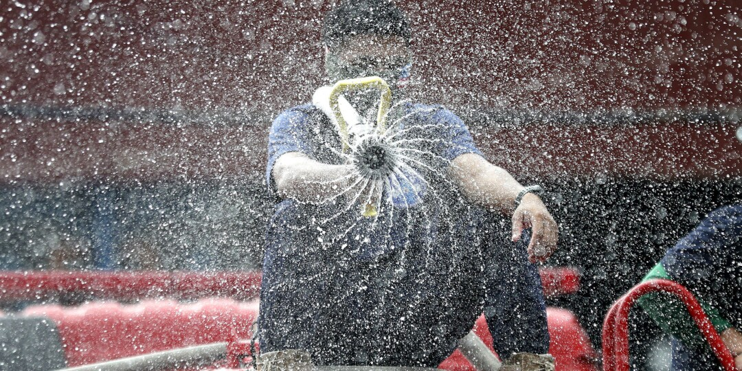 A firefighter sprays disinfectant outside a public market in Manila on Wednesday.