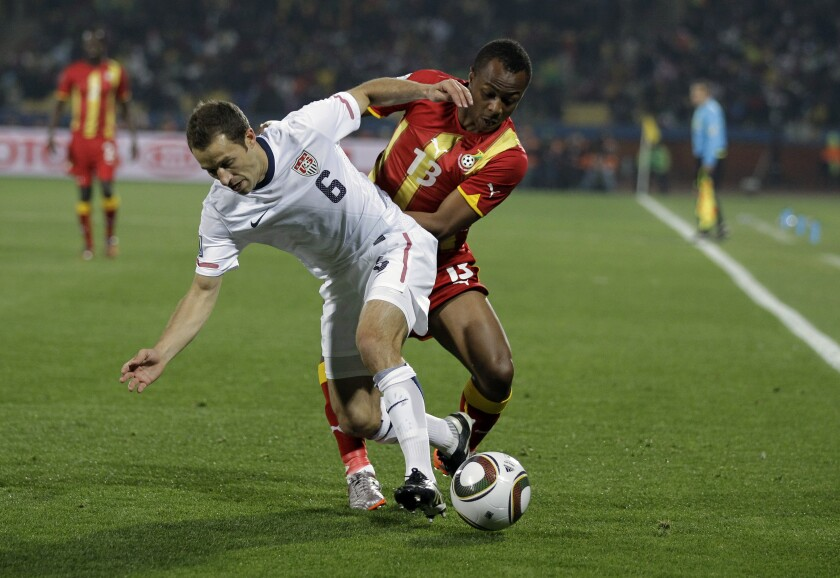 FILE - In this June 26, 2010, file photo, United States' Steve Cherundolo, left, and Ghana's Dede Ayew, right, compete for the ball during a World Cup round of 16 soccer match in Rustenburg, South Africa. American national team defenders Cherundolo and Christie Pearce have been elected to the U.S. National Soccer Hall of Fame. (AP Photo/Matt Dunham, File)