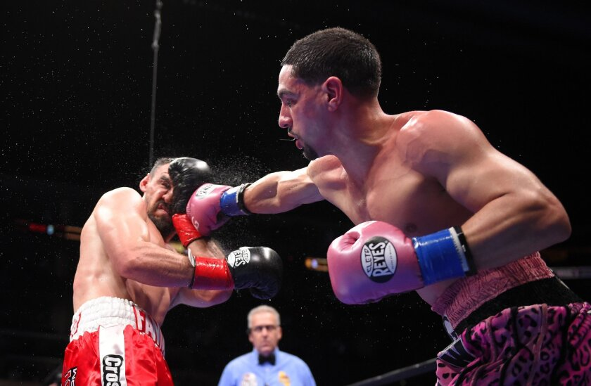 Danny Garcia, right, throws a punch at Robert Guerrero during their WBC championship welterweight bout, Saturday, Jan. 23, 2016, in Los Angeles. (AP Photo/Mark J. Terrill)