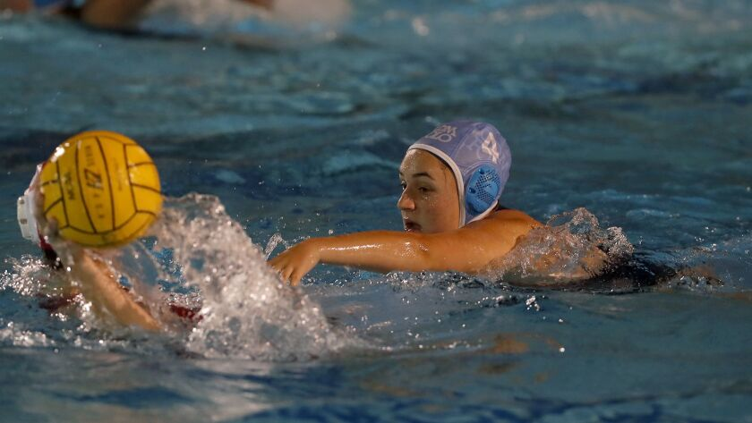 Corona del Mar High's Kaity Greenwald (4) defends against Orange Lutheran during the first half in a