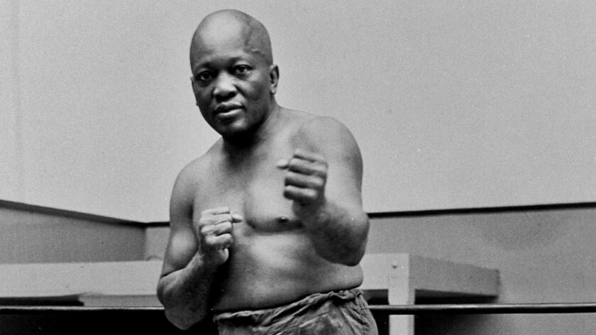 FILE - In this 1932 file photo, boxer Jack Johnson, the first black world heavyweight champion, pose