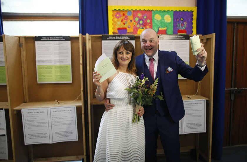 "Newly weds Ann Cole and Vincent Fox prepare to cast their vote at a polling station in Dublin, Ireland, Friday, May 22, 2015. Ireland began voting Friday in a referendum on Gay marriage which will require an amendment to the Irish constitution. For months, Ireland has debated whether to legalize gay marriage. Now it's time to vote, and the choice is a simple yes or no. Friday's referendum on amending the Irish constitution to give marriage rights to homosexuals is expected to be approved, based on opinion polls that consistently gave ""yes"" voters a double-digit lead throughout the two-month campaign. (AP Photo/Peter Morrison)"