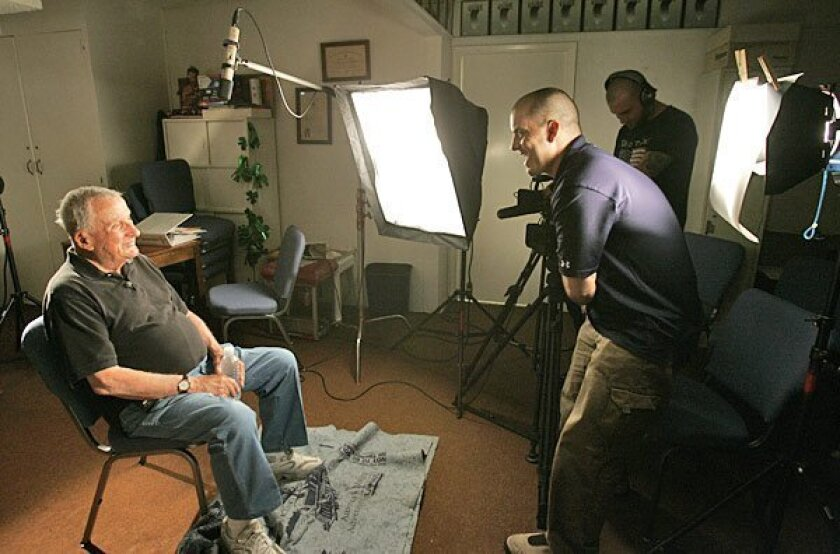 "Dan Bledsoe (left) of Mount Helix spoke to Brian Iglesias, producer of ""The Chosin Few,"" a Korean War documentary. Local veterans who fought in the battle were interviewed at American Legion Post 6 in San Diego. (Howard Lipin / Union-Tribune)"