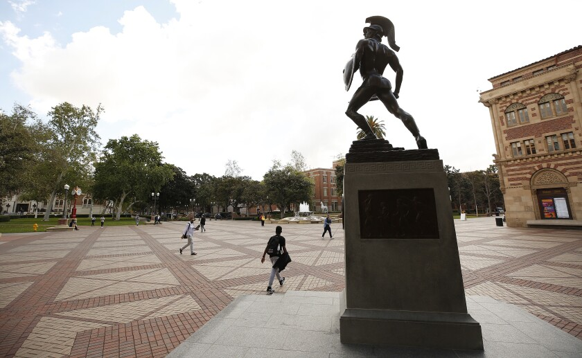 Tommy Trojan stands guard over a quiet USC campus