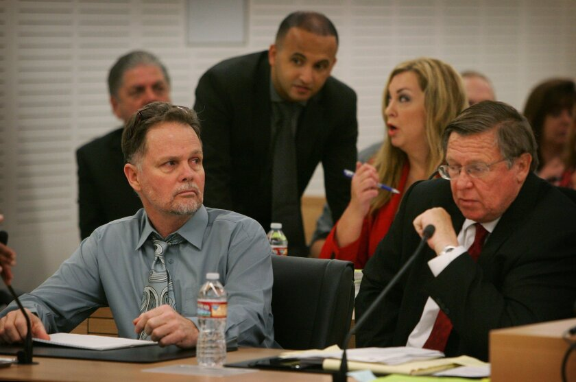 """Charles Merritt, left, sits in Department S-1 of the San Bernardino Justice Center, with defense attorneys Jimmy Mettias, left, Sharon Brunner and Jim Terrell before the start of his preliminary hearing on Monday, June 15, 2015, in San Bernardino, Calif. Merritt is accused of killing four members of the McStay family in February 2010. A judge will decide whether Charles """"Chase"""" Merritt, 58, must stand trial for the deaths of his business partner, Joseph McStay, the man's wife and their two young sons. (Kurt Miller/The Press-Enterprise via AP, Pool)"""