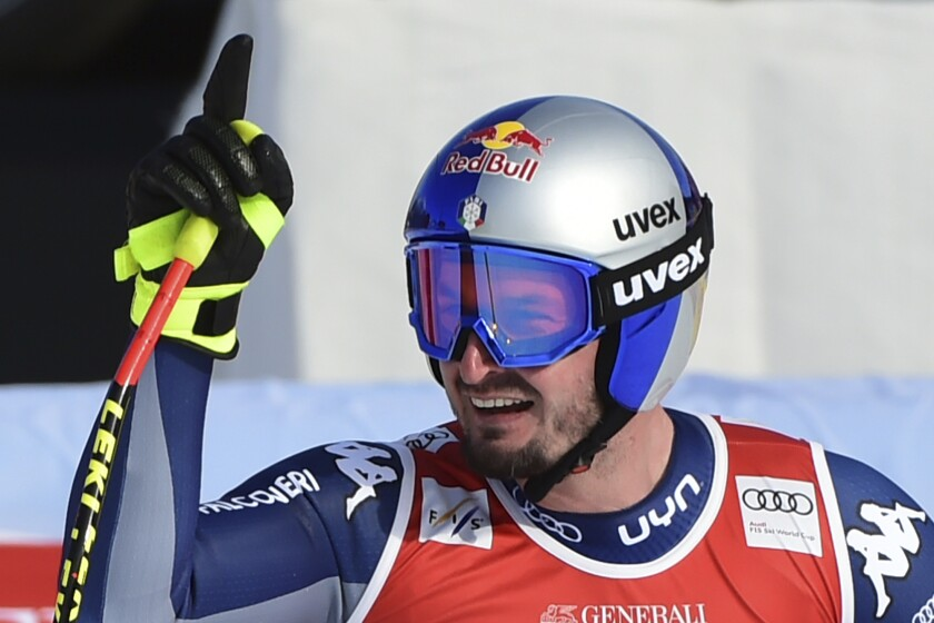 Italy's Dominik Paris reacts after completing an alpine ski, men's World Cup downhill, in Garmisch-Partenkirchen, Germany, Friday, Feb. 5, 2021. (AP Photo/Marco Tacca)