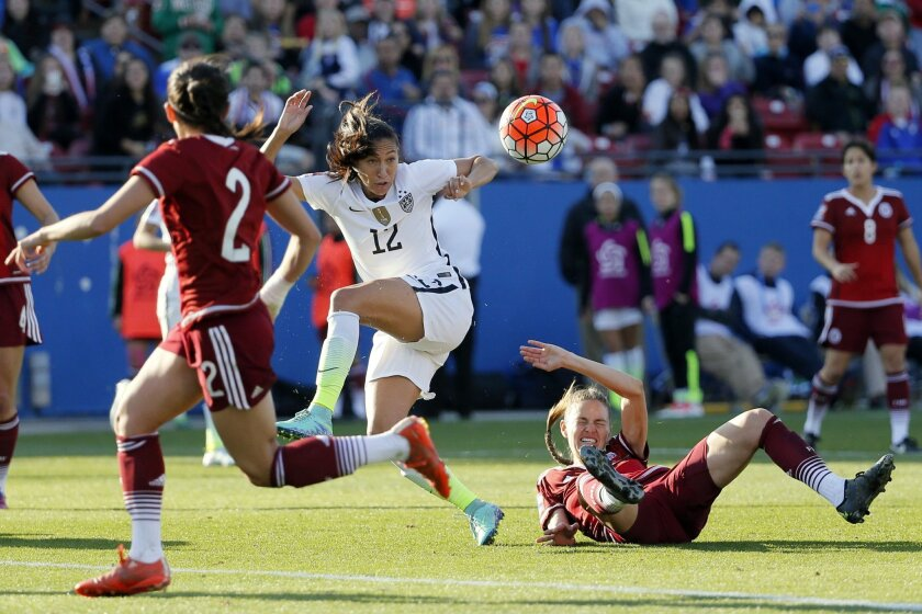 Mexico defender Arianna Romero (2) watches as Ganelly Farias (3) is knocked to the ground stripping control of the ball away from United States forward Christen Press (12) in the second half of a CONCACAF Olympic qualifying tournament soccer match, Saturday, Feb. 13, 2016, in Frisco, Texas. The U.S