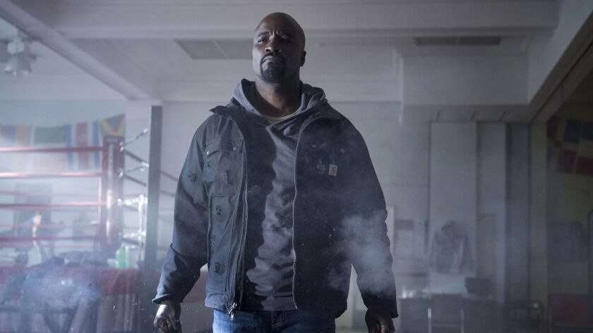 """This image released by Netflix shows Mike Colter in a scene from """"Marvel's Luke Cage,"""" premiering it"""