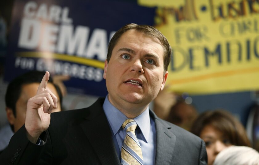 Republican congressional candidate in the 52nd district, Carl DeMaio, offers a stern condemnation of accusations made by his opponent Scott Peters while addressing the media with his final thoughts on election eve, Monday, Nov. 3, 2014, in San Diego. (AP Photo/Lenny Ignelzi)