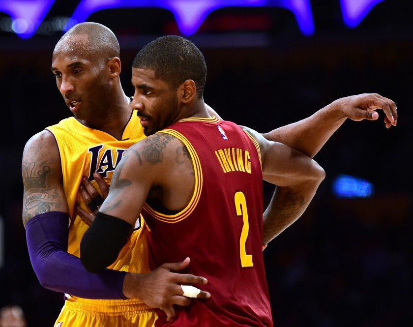 Lakers forward Kobe Bryant (24) guards Cavaliers point guard Kyrie Irving (2).