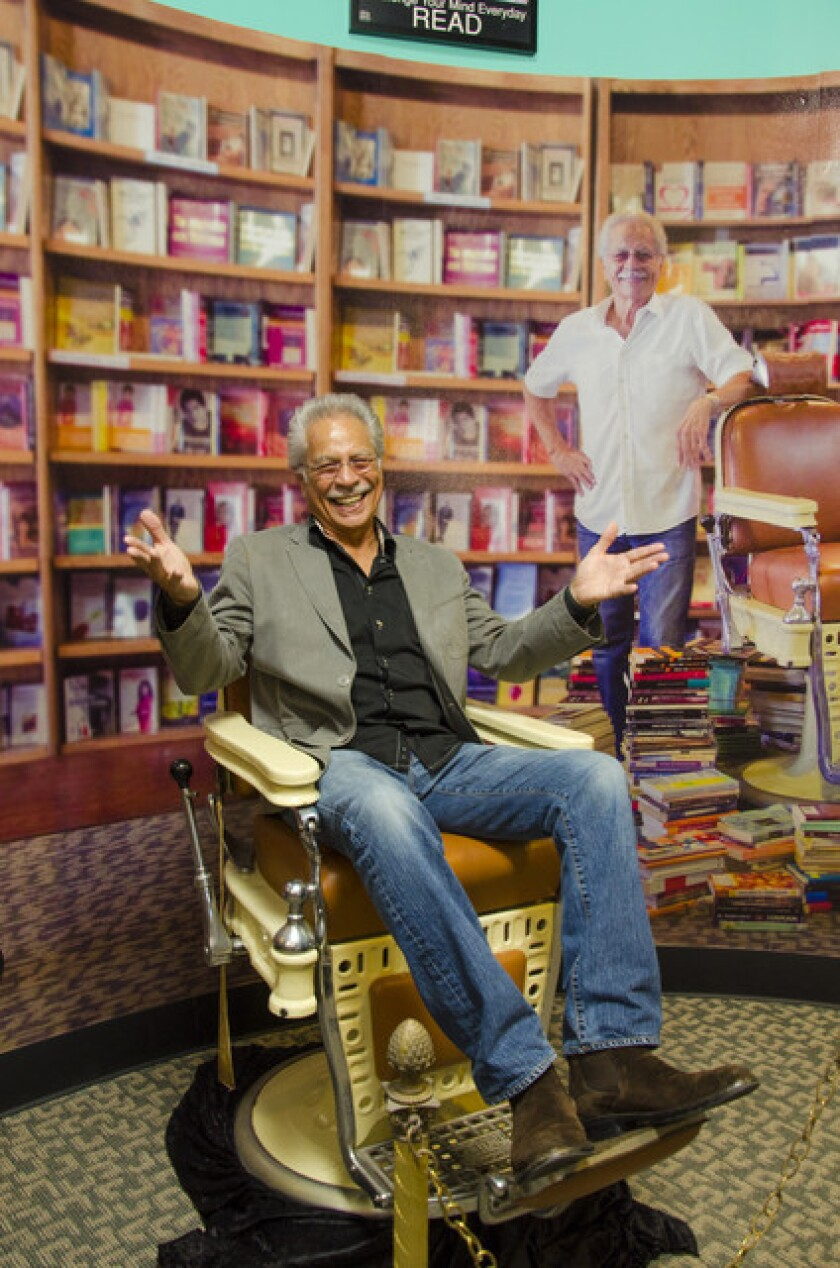 Rueben Martinez, founder of the Liberia Martinez Bookstore, sits in a barber chair in his newly renovated bookstore, now operated in alliance with Chapman University. Martinez began selling books while cutting hair in his barbershop.