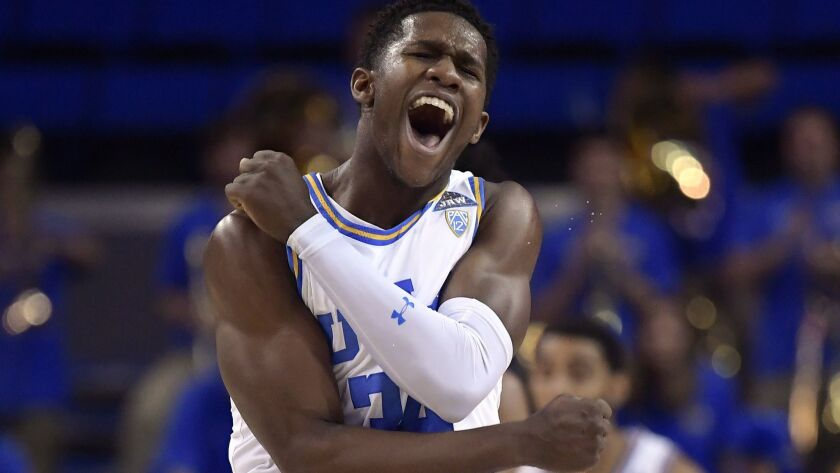 UCLA guard David Singleton celebrates during a game against Stanford in January. UCLA coach Mick Cronin knows all about Singleton's on-court tenacity.