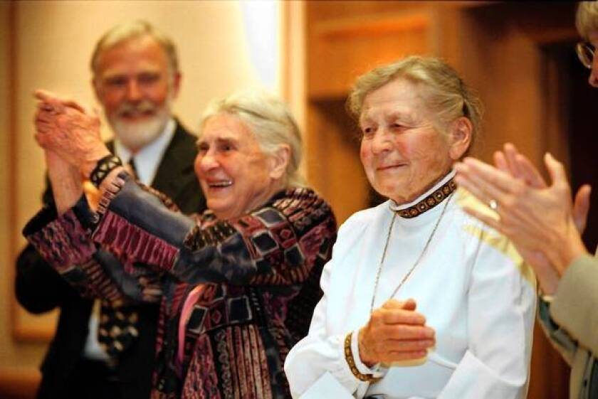 Celia Hunter, left, and Ginny Wood were honored in 2001 for their efforts in co-founding the Alaska Conservation Society.