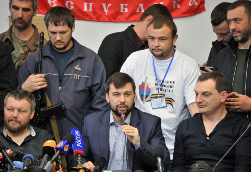 "Denis Pushilin, at the microphone, told reporters in Donetsk on Thursday that separatists in the eastern Ukrainian region have rejected Russian President Vladimir Putin's ""respected"" advice to postpone a Sunday referendum on secession from Ukraine."