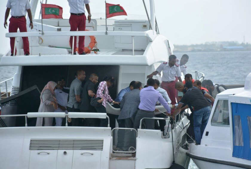 Unidentified injured people are evacuated after a blast on the Maldives President Yameen Abdul Gayoom speedboat in Male, Maldives Monday, Sept. 28, 2015. Gayoom's wife Fathimath Ibrahim and several officials suffered minor injuries. The country's international airport is on a separate island and a short boat trip is needed to reach the capital island. (Yoosuf Sofwan/Sun Online via AP) NO ARCHIVE, NO SALES