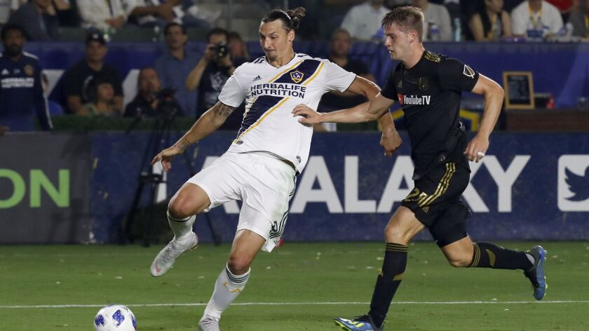 CARSON, CALIF. - AUG. 24, 2018. Galaxy forward Zlatan Ibrahimovic tries to get the ball inside agai