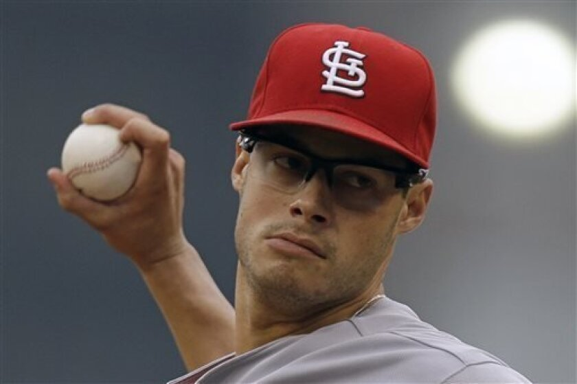 St. Louis Cardinals relief pitcher Joe Kelly (58) delivers during the first inning of a baseball game against the St. Louis Cardinals in Pittsburgh Sunday, Sept. 1, 2013. (AP Photo/Gene Puskar)