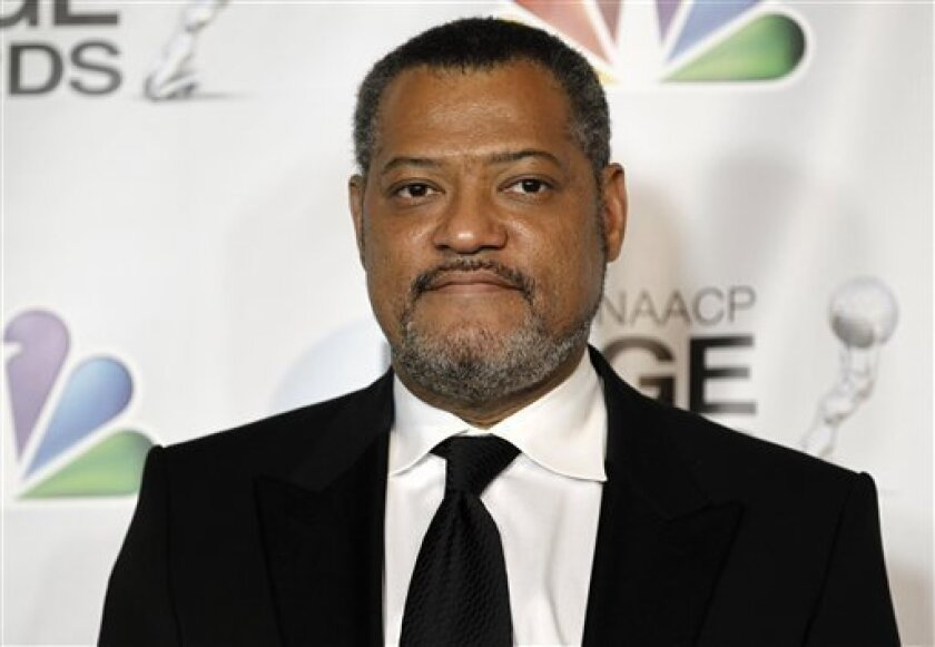 """FILE - In this Feb. 17, 2012 file photo, Laurence Fishburne, winner of the awards for outstanding actor in a television movie, mini-series or dramatic special and outstanding television movie, mini-series or dramatic special for """"Thurgood"""" poses backstage at the 43rd NAACP Image Awards in Los Angeles. Court records show Fishburne was granted a temporary restraining order on Thursday Jan. 3, 2012 against a man who claims to own the actor's house and went there on New Year's day to try to evict him and his family. Fishburne's filing states police told him that the man was recently released from parole for a previous cyberstalking and criminal threats conviction. (AP Photo/Matt Sayles, File)"""