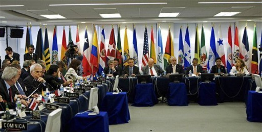 The Organization of American States meets in emergency session, in at the OAS in Washington, to consider suspending Honduras' membership because of the coup that ousted Honduran president Manuel Zelaya, Saturday, July 4, 2009. (AP Photo/Manuel Balce Ceneta)