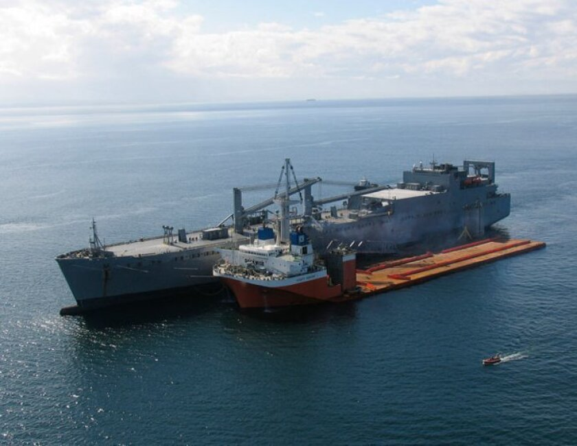 The Navy tested the concept of a Mobile Landing Platform off  San Diego using the USNS Red Cloud (right) and the MSC-chartered MV Mighty Servant. Image courtesy of U.S. Navy
