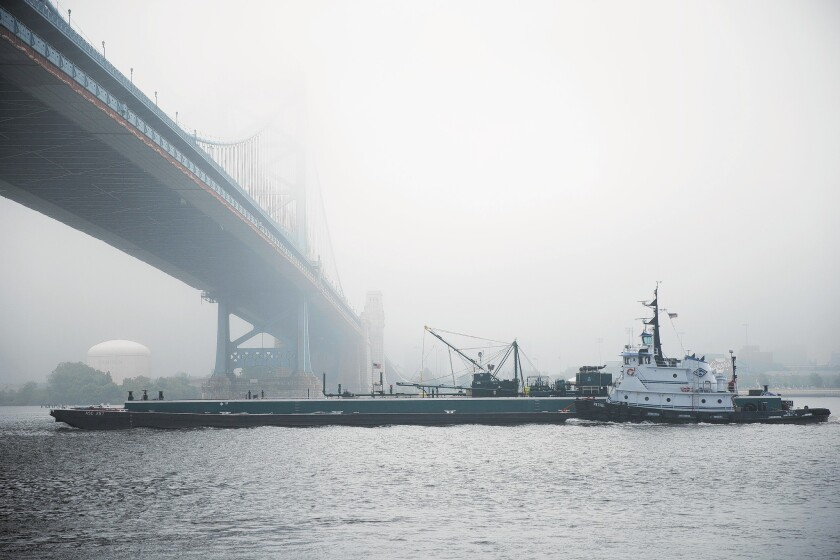 A tugboat pushes a barge on the Delaware River in Philadelphia. Researchers found intersex fish in the Delaware, Ohio and Susquehanna river basins, suggesting the presence of chemical contaminants.