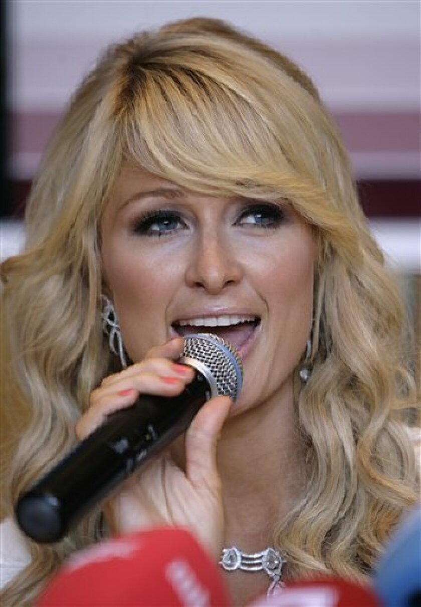FILE - In this July 3, 2009 file photo, Paris Hilton speaks during a news conference in Broumana, east of Beirut, Lebanonl. (AP Photo/Grace Kassab, file)
