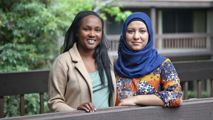 Founder Meymuna Hussein-Cattan, and Laza Popal, a chef in the refugee chefs program, from left, at t