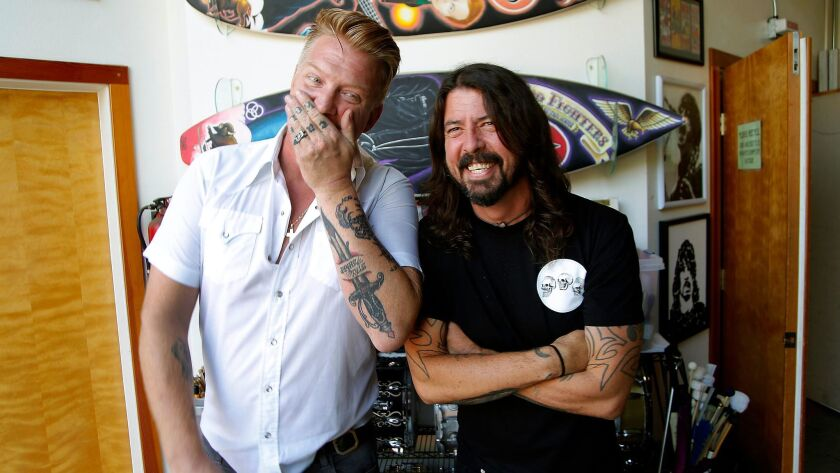 NORTHRIDGE, CA.,SEPTEMBER 1, 2017-- (l to r) Josh Homme (of Queens of the Stone Age) and Dave Grohl
