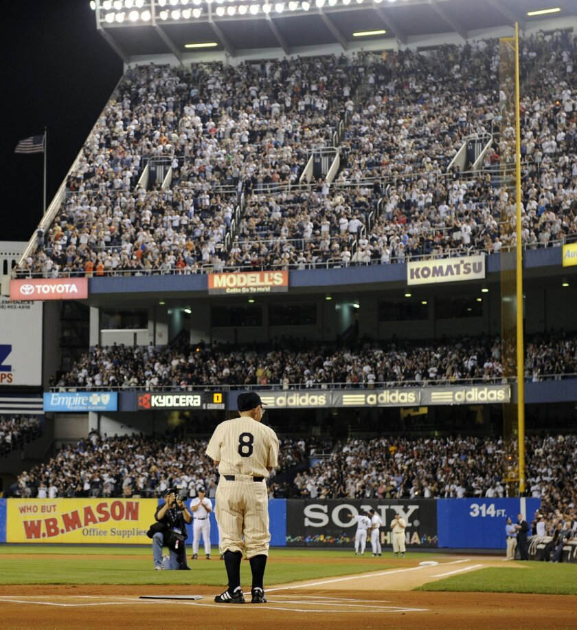 """FILE - In this Sept. 21, 2008, file photo, former New York Yankees catcher Yogi Berra stands at home plate at Yankee Stadium in New York, before the Yankees played the Baltimore Orioles in the final regular season baseball game at the stadium. The Hall of Fame catcher renowned as much for his lovable, linguistically dizzying """"Yogi-isms"""" as his unmatched 10 World Series championships with the New York Yankees, died Tuesday, Sept. 22, 2015. He was 90. (AP Photo/Ed Betz, File)"""