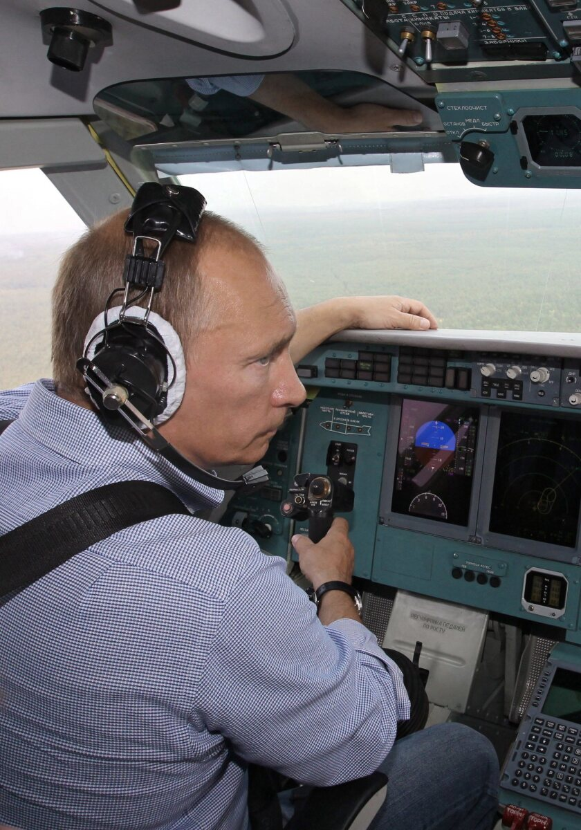 Russian Prime Minister Vladimir Putin in a BE200 firefighting aircraft over the Ryazan region on Aug. 10, 2010. Putin took part in the firefighting action as the second pilot of the aircraft.