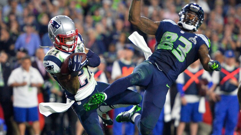Patriots cornerback Malcolm Butler intercepts a pass intended for Seattle Seahawks receiver Ricardo Lockette during the final seconds of the Patriots' 28-24 victory in Super Bowl XLIX.