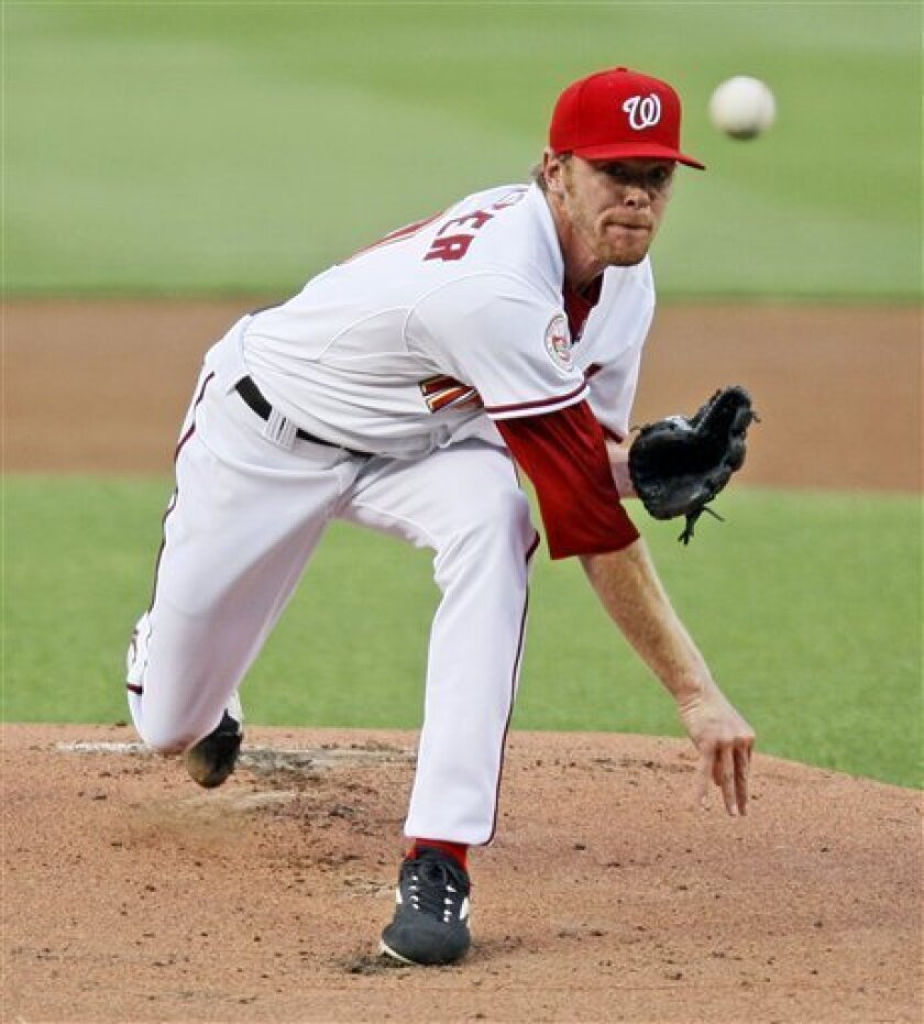 Washington Nationals starting pitcher Collin Balester delivers to the Philadelphia Phillies during the first inning of a baseball game, Tuesday, July 29, 2008 in Washington. (AP Photo/Charles Dharapak)