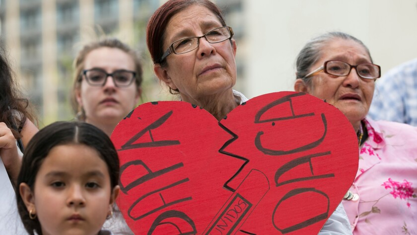 Angela Reyes holds a sign while participating in a vigil at the Governor's Mansion in Austin, Texas, on June 23 in response to the Supreme Court decision about President Obama's immigration executive order.