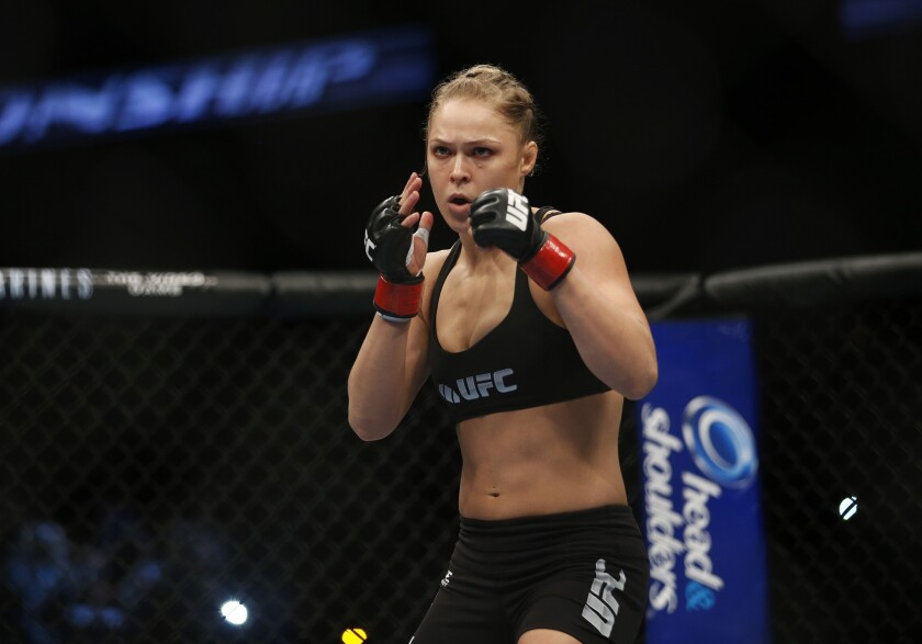 Ronda Rousey gets ready for her women's bantamweight championship fight against Liz Carmouche in Anaheim for UFC 157 on Feb. 23, 2013.