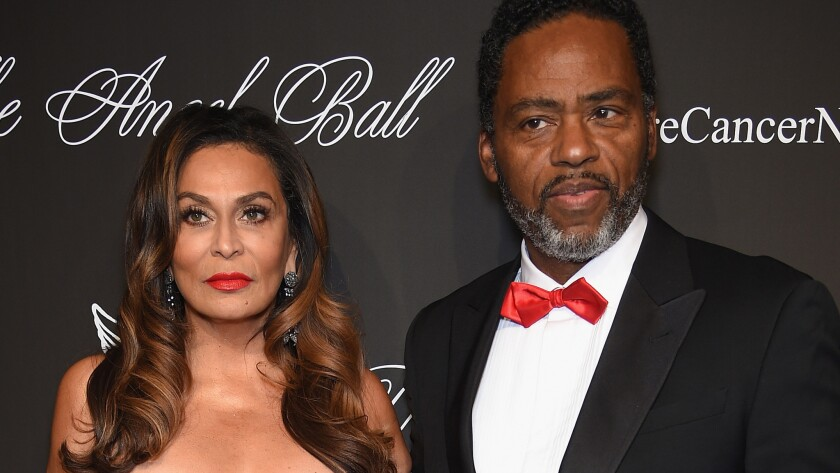 Tina Knowles and Richard Lawson looked very serious at a charity event in October, but were all smiles in a picture Beyonce posted of the newlyweds taken Sunday on a yacht off Newport Beach.