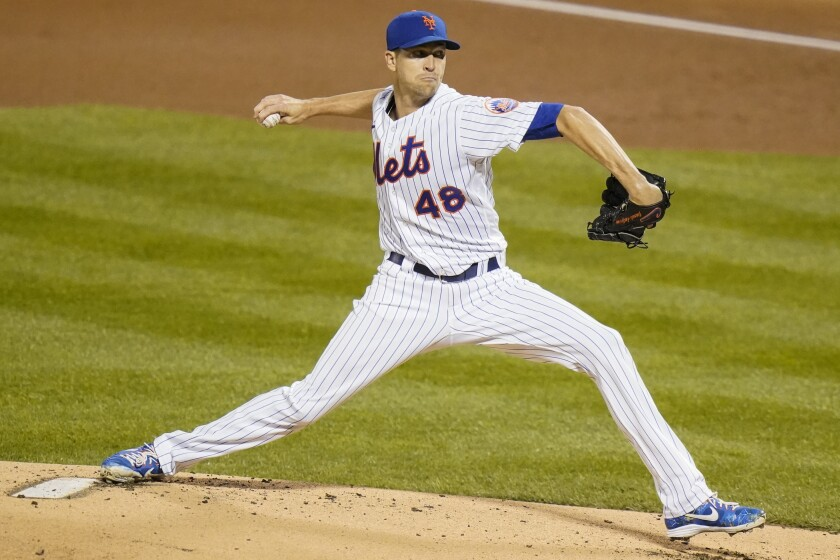 New York Mets' Jacob deGrom delivers a pitch during the first inning of a baseball game against the Tampa Bay Rays Monday, Sept. 21, 2020, in New York. (AP Photo/Frank Franklin II)