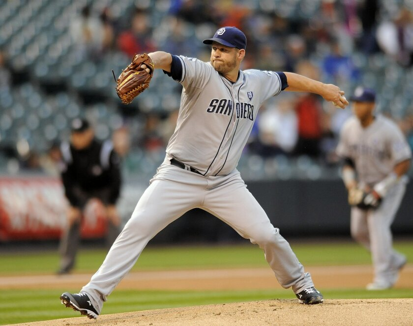 San Diego Padres starting pitcher Eric Stults throws in the first inning of a baseball game against the Colorado Rockies on Friday, Sept. 5, 2014, in Denver. (AP Photo/Chris Schneider)