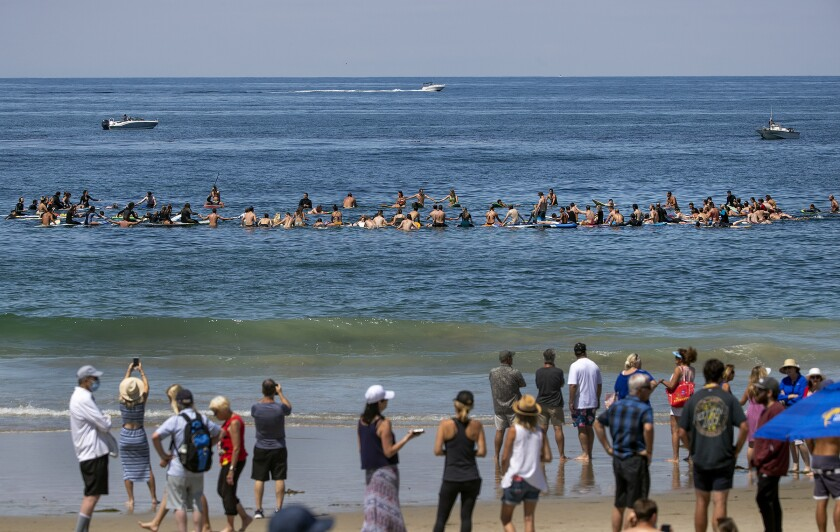 Family and friends of former USC lineman Max Tuerk celebrated his life on Saturday at Salt Creek Beach in Dana Point.