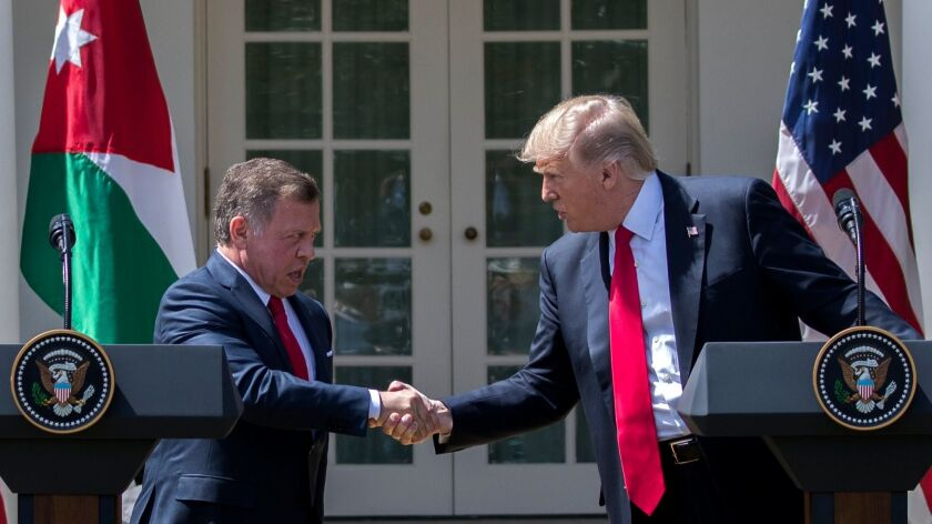 epa05890642 US President Donald J. Trump (R) and King Abdullah II of Jordan (L) shake hands while pa