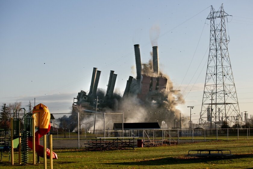 The former DTE Energy power plant is imploded Saturday, Nov. 7, 2015 in Marysville, Mich.  The planned destruction of the unused plant, 55 miles northeast of Detroit, attracted spectators on both sides of the St. Clair River, which separates Michigan and Ontario, Canada. (Jeffrey M. Smith/The Times
