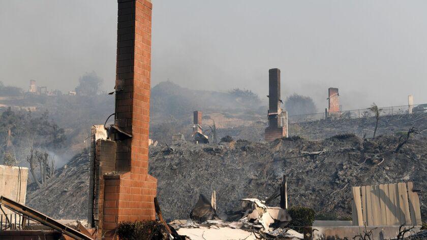 VENTURA, CA - DECEMBER 5, 2017: Three chimneys remain from burn houses on three adjoining propertie