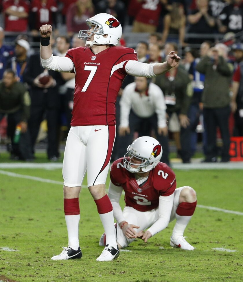 Arizona Cardinals kicker Chandler Catanzaro (7) watches his game-winning field goal split the uprights against the Cincinnati Bengals during the second half of an NFL football game, Sunday, Nov. 22, 2015, in Glendale, Ariz. The Cardinals won 34-31. (AP Photo/Ross D. Franklin)