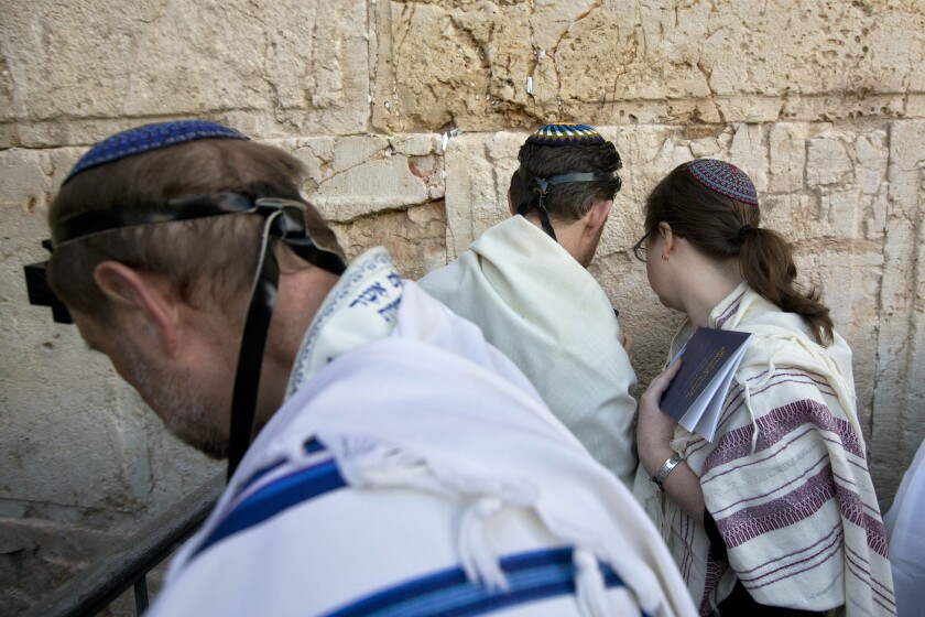 Rabbis pray at Jerusalem's Western Wall