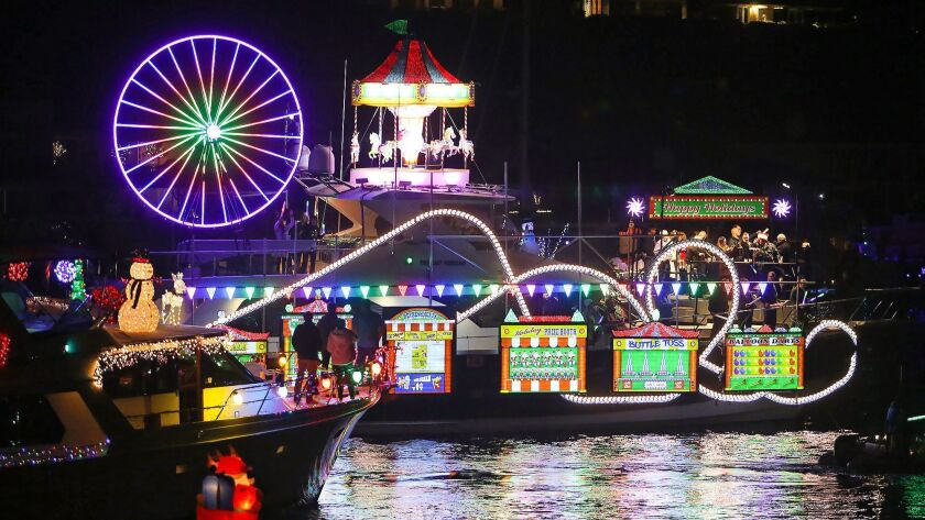 A colorful boat decorated in the theme of a circus lights up the Balboa Bridge turn around, during t