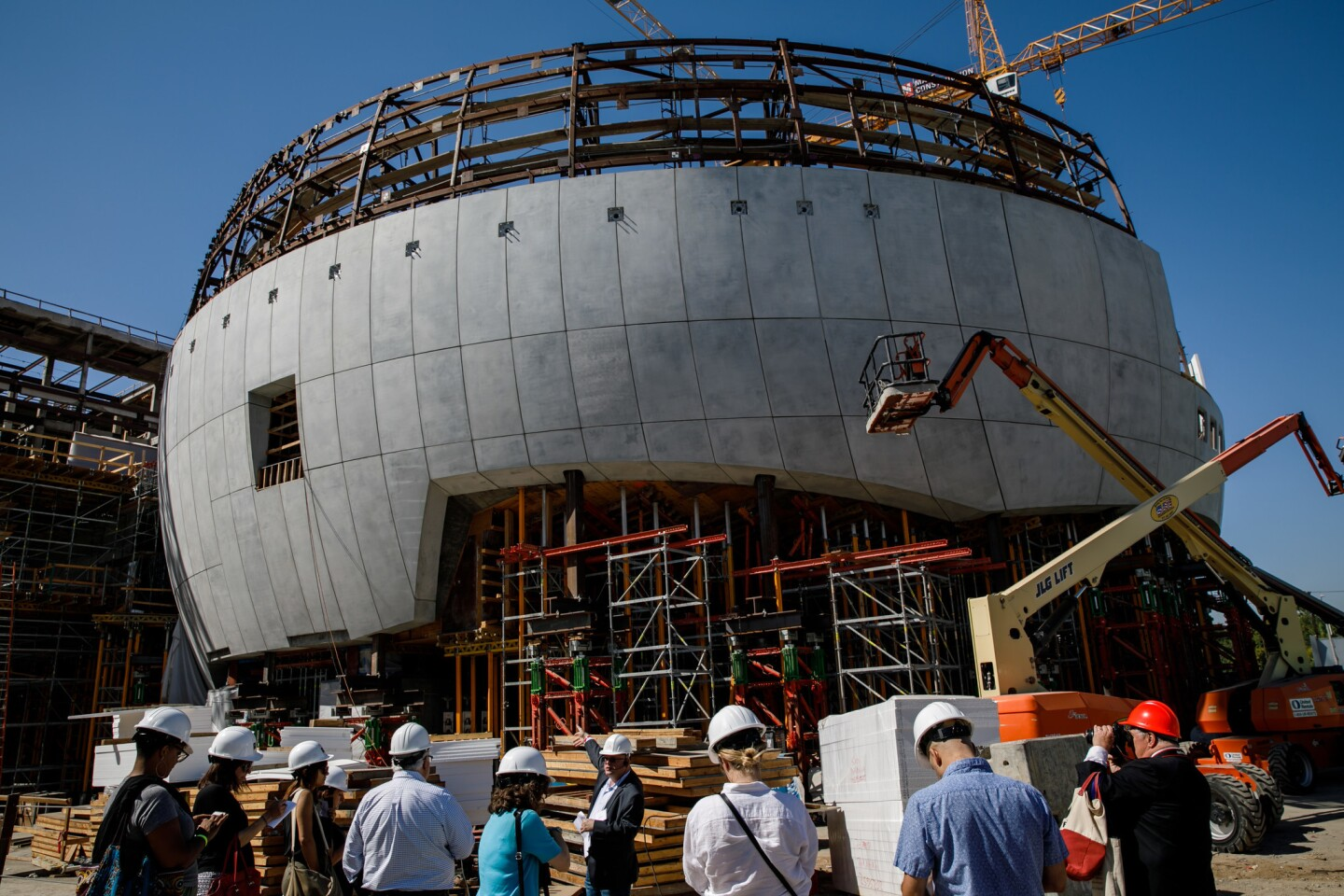 Rich Cherry leads reporters on a tour of the construction site of the Academy Museum of Motion Pictures in Los Angeles on Sept. 27, 2017.