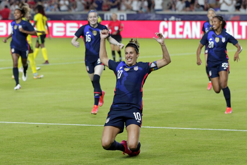U.S. forward Carli Lloyd slides on the turf after scoring in the first minute of a 4-0 win over Jamaica.