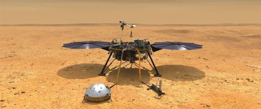 Fotografía cedida por la NASA de una ilustración que muestra una vista simulada del módulo espacial InSight mientras reduce la velocidad a medida que desciende hacia la superficie de Marte. EFE/NASA/JPL-Caltech