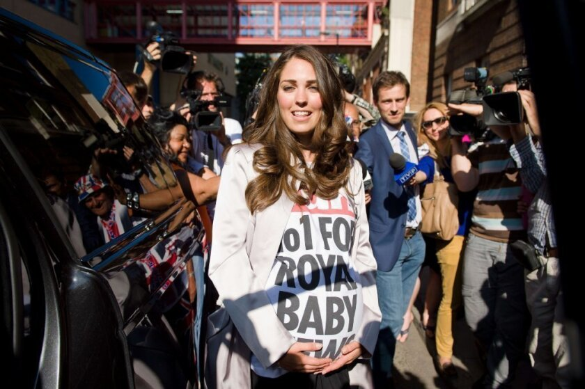 A lookalike of Catherine, Duchess of Cambridge, was among the crowd outside London's St. Mary's Hospital on Friday. Media are awaiting the birth of Will and Kate's new baby.