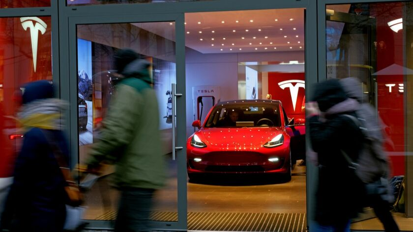 A Tesla car in a showroom.